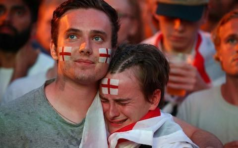 <span>England fans watch Croatia v England - Brighton Beach</span> <span>Credit: Reuters </span>