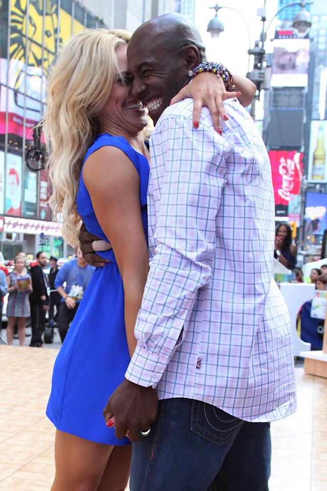 """NEW YORK, NY - MAY 23:  """"Dancing With The Stars"""" winners Peta Murgatroyd and Donald Driver (R) perform on ABC's """"Good Morning America"""" in Times Square on May 23, 2012 in New York City.  (Photo by Taylor Hill/Getty Images)"""