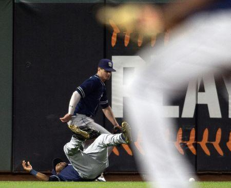 Jun 21, 2018; San Francisco, CA, USA; San Diego Padres center fielder Manuel Margot (left) and left fielder Wil Meyers chase down a double off the bat of San Francisco Giants Joe Panik (not pictured) in the seventh inning at AT&T Park. Mandatory Credit: D. Ross Cameron-USA TODAY Sports