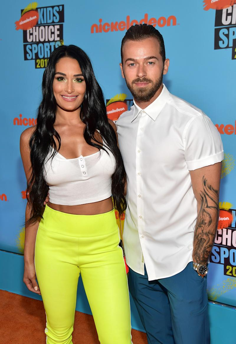 """Nikki Bella says fiancé Artem Chigvintsev is happy to be back on """"Dancing With the Stars."""""""