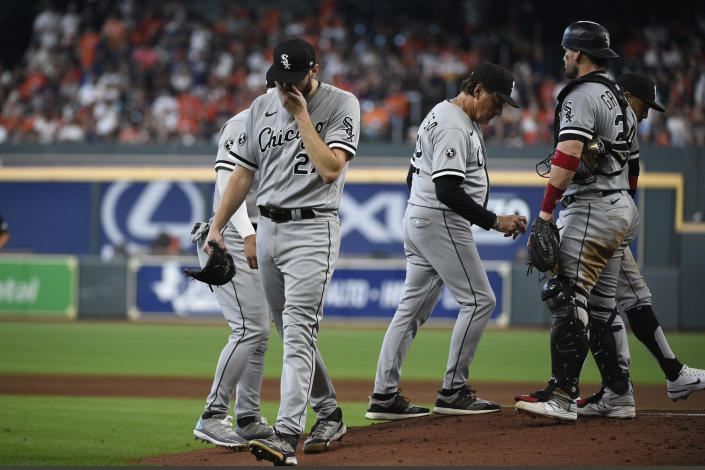 Chicago White Sox starting pitcher Lucas Giolito (27) is pulled from the game during the fifth inning in Game 2 of a baseball American League Division Series against the Houston Astros, Friday, Oct. 8, 2021, in Houston. (AP Photo/Eric Christian Smith)