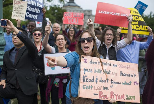"Protesters yell ""shame'"" to members of Congress on the East Front of the Capitol after the House passed the Republicans' bill to repeal and replace the Affordable Care Act on May 4, 2017. (Photo: Tom Williams/CQ Roll Call/Getty Images)"