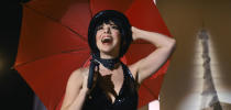 """This image released by Netflix shows Krysta Rodriguez as Liza Minnelli in a scene from """"Halston."""" (Netflix via AP)"""