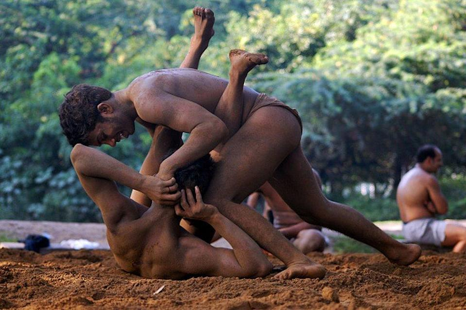 Indian wrestlers fight during a practice session, at an Akhara (wrestling) ground on the outskirts of New Delhi, 22 September 2007.