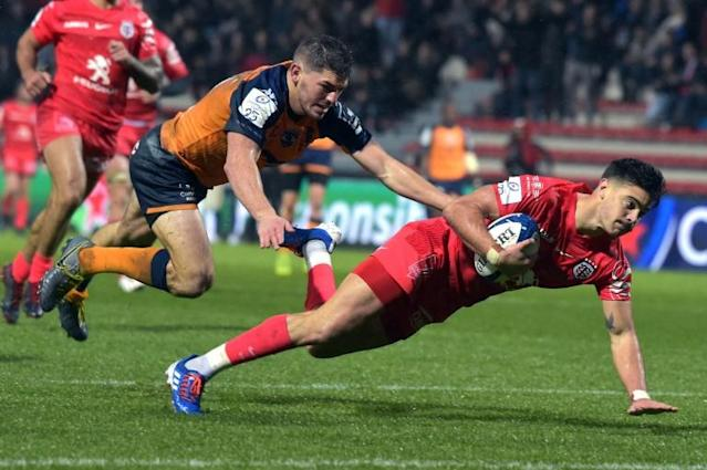 Toulouse fly-half Romain Ntamack scores the opening try in their 26-18 win over Montpellier (AFP Photo/PASCAL PAVANI)
