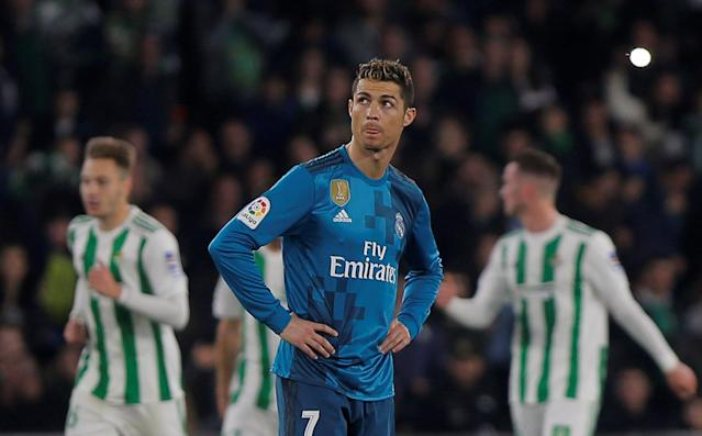 Soccer Football - La Liga Santander - Real Betis vs Real Madrid - Estadio Benito Villamarin, Seville, Spain - February 18, 2018 Real Madrid's Cristiano Ronaldo reacts after Real Betis' Aissa Mandi scores their first goal REUTERS/Jon Nazca