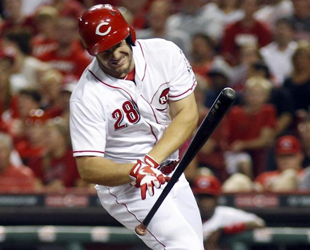 Cincinnati Reds' Chris Heisey reacts after being hit by a pitch from Los Angeles Dodgers pitcher Clayton Kershaw in the third inning of a baseball game, Sunday, Sept. 8, 2013, in Cincinnati. (AP Photo/David Kohl)