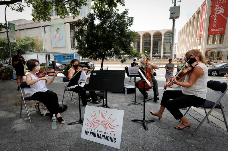 FILE PHOTO: A string quartet made up of musicians from the New York Philharmonic Orchestra play first public performance since March in New York