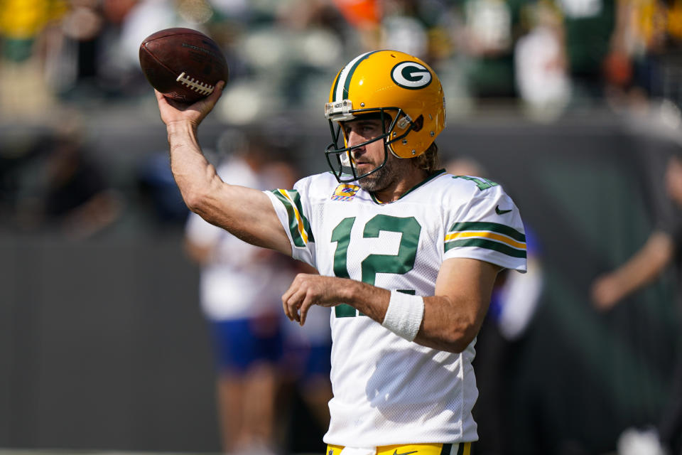 Aaron Rodgers and the Packers edged the Bengals in a wild game. (AP Photo/Bryan Woolston)