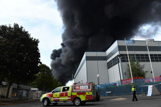 Smoke at the scene of a severe blaze as crews from 10 fire engines tackle a large fire on an industrial estate in Birmingham.