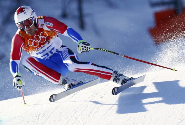 France's Adrien Theaux skis during the downhill run of the men's alpine skiing super combined event at the 2014 Sochi Winter Olympics at the Rosa Khutor Alpine Center February 14, 2014. REUTERS/Ruben Sprich (RUSSIA - Tags: SPORT SKIING OLYMPICS)