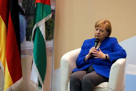 German Chancellor Angela Merkel speaks during her visit to the German Jordanian University near Madaba, Jordan June 21, 2018. REUTERS/Muhammad Hamed