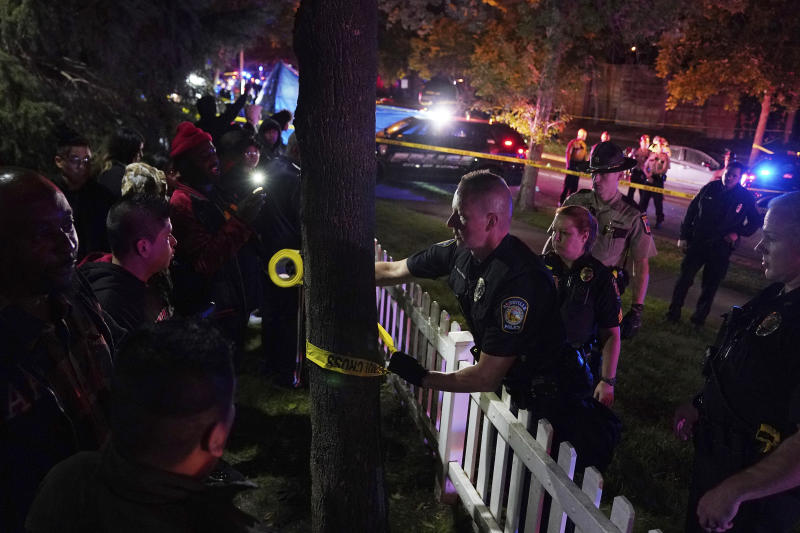 Police put up tape in an area near an officer involved shooting on East 77th Street in Richfield, Minn., Saturday night, Sept. 7, 2019. Police near Minneapolis shot and killed a driver following a chase after he apparently emerged from his car holding a knife and refused their commands to drop it. The chase started late Saturday night in Edina and ended in Richfield with officers shooting the man, Brian J. Quinones, who had streamed himself live on Facebook during the chase. (Anthony Souffle/Star Tribune via AP)