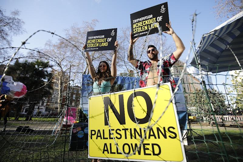 Rights group Amnesty International stages a demonstration outside the UK headquarters of US travel company TripAdvisor in London on January 30, 2019 (AFP Photo/Tolga AKMEN)