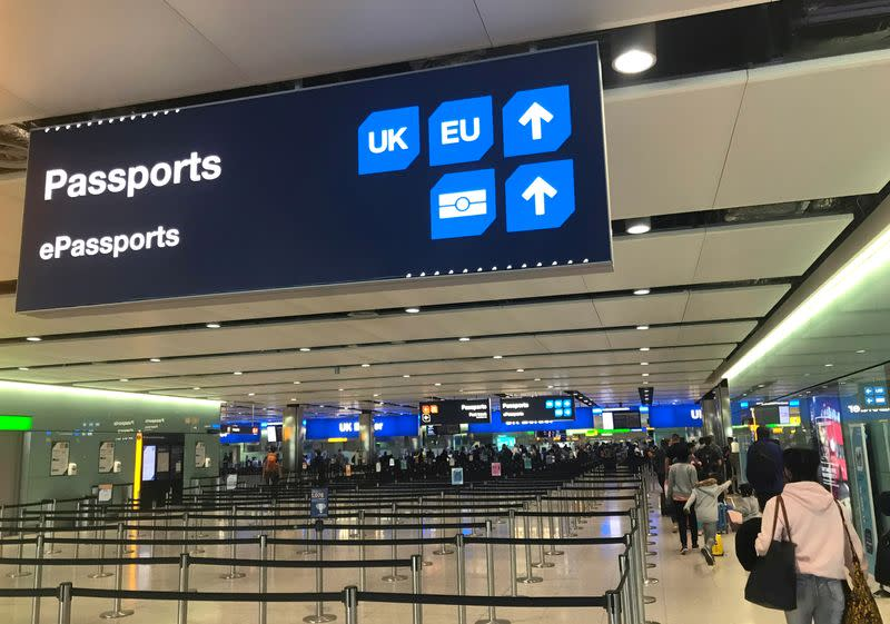 Signage is seen at the UK border control point at the arrivals area of Heathrow Airport, London