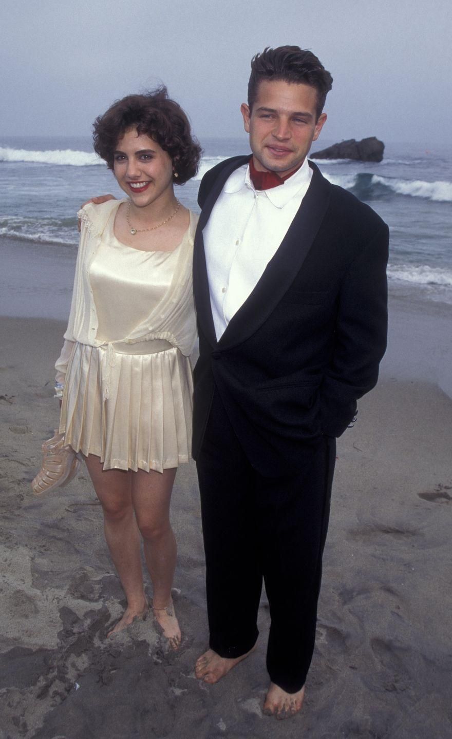 <p>Brittany Murphy (may she rest in peace), and Justin Walker also paired their formal attire with bare feet during the event. </p>