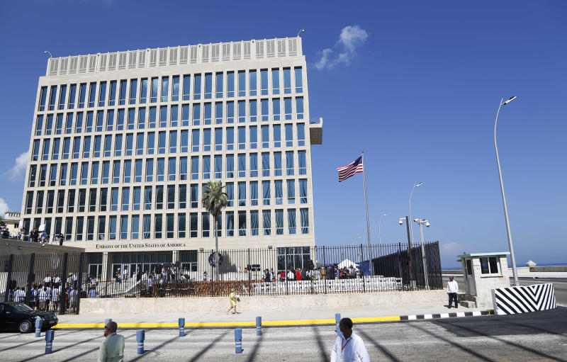 """FILE - This Aug. 14, 2015 file photo shows the U.S. embassy in Havana, Cuba. Cuba released details Sunday, June 10, 2018 on the latest mysterious health incident involving a U.S. diplomat in the country, saying officials learned of the episode late May 2018 when the U.S. said an embassy official felt ill after hearing """"undefined sounds"""" in her home.  U.S. officials said June 8, 2018 that they had pulled two workers from Cuba and were testing them for possible brain injury.  (AP Photo/Desmond Boylan, File)"""