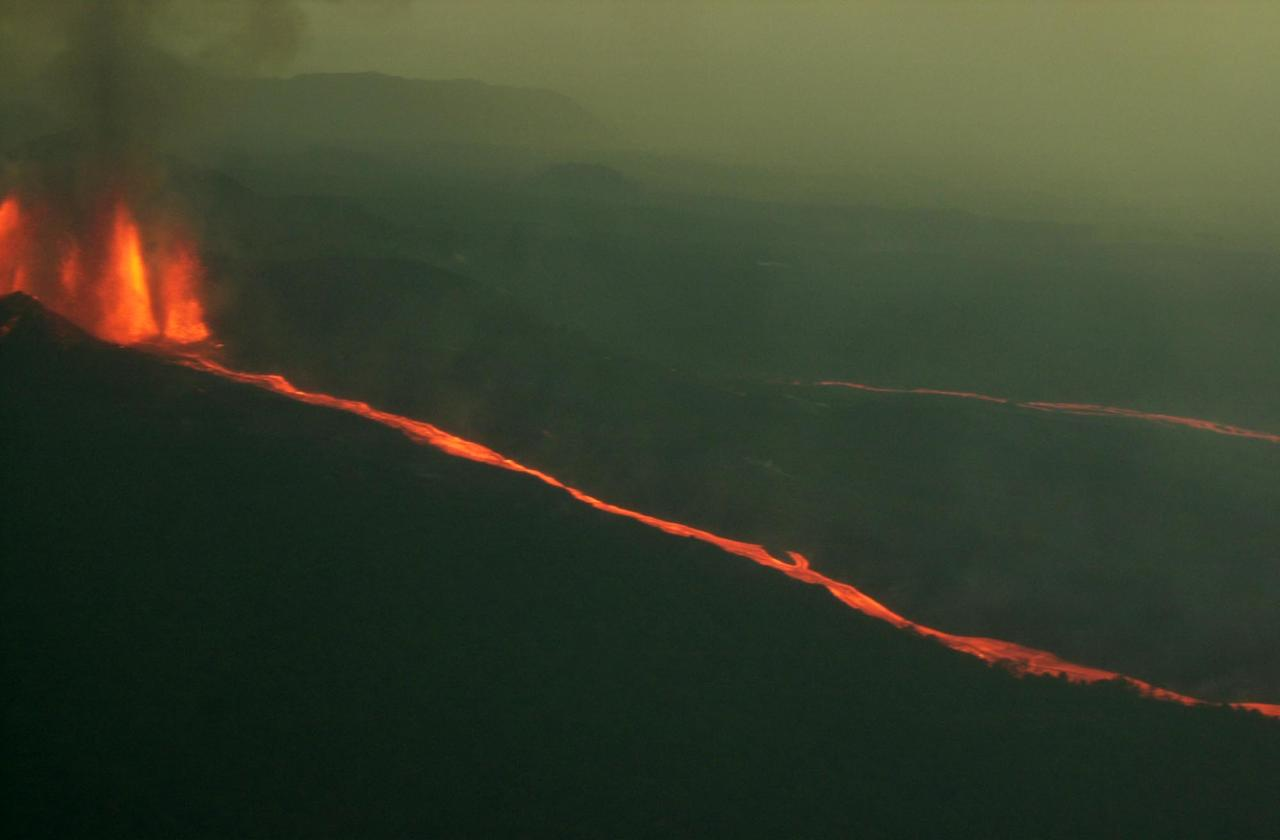 A stream of lava flows into Virunga National Park from Mount Nyamulagira, Sunday, July 28, 2002. Scientists said the volcano posed no direct threat to nearby Goma, which was devastated by an eruption earlier this year.(AP Photo/Sayyid Azim)