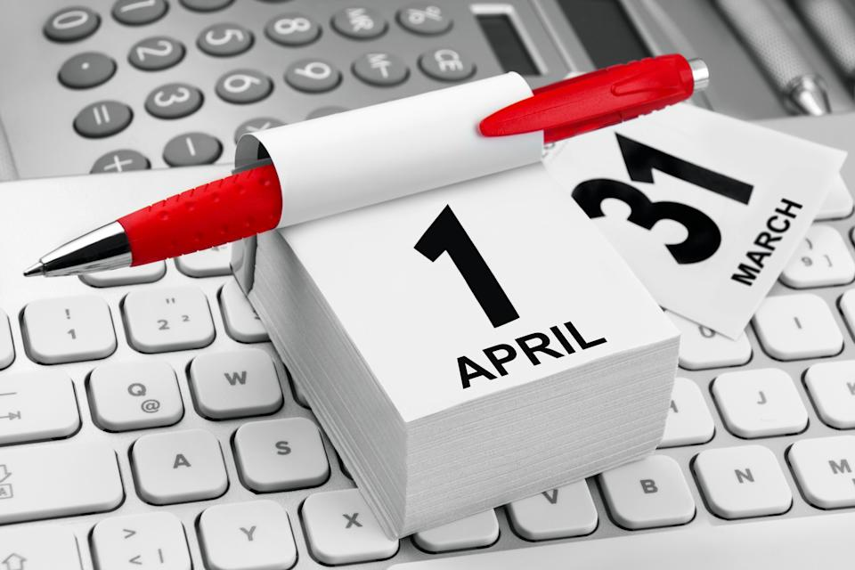Workplace with calendar April 1 and PC Keyboard close up
