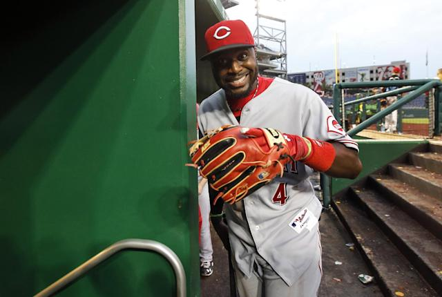 Cincinnati Reds second baseman Brandon Phillips smiles as he heads into the clubhouse after a baseball game against the Washington Nationals at Nationals Park Wednesday, May 21, 2014, in Washington. The Reds won 2-1. (AP Photo/Alex Brandon)