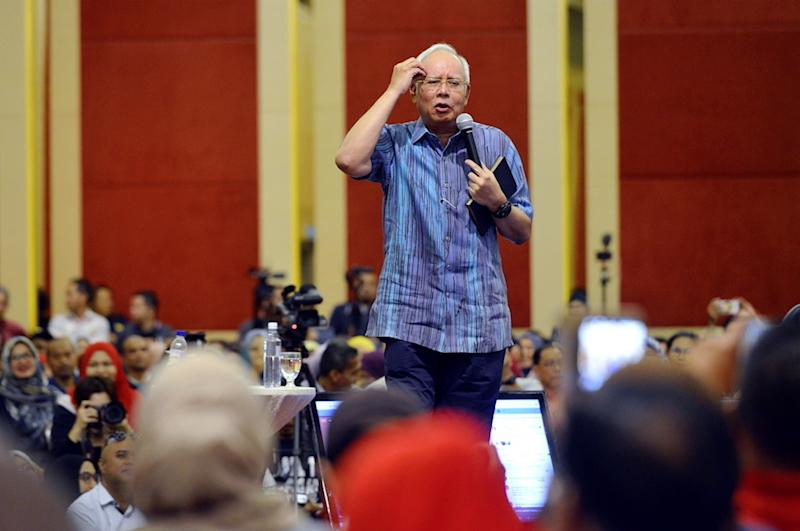 Datuk Seri Najib Razak expressed his belief that the raids were pursuant to a police report lodged by former Umno member Datuk Seri Khairuddin Abu Hassan about 1MDB in late 2014 and before the scandal exploded into the world stage. — Picture by Ham Abu Bakar