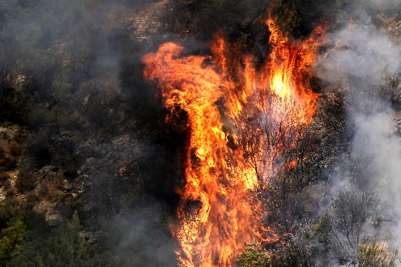 Fire takes out forests in the mountainous area that flank Damour river near the village of Meshref in Lebanon's Shouf mountains, southeast of the capital Beirut. (Photo by JOSEPH EID / AFP) (Photo by JOSEPH EID/AFP via Getty Images)