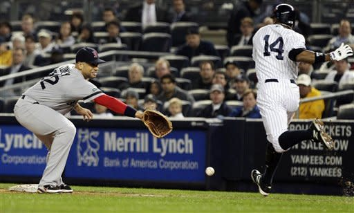 New York Yankees' Curtis Granderson (14) beats the throw to first base as Boston Red Sox first baseman James Loney tries to catch the ball during the second inning of a baseball game, Tuesday, Oct. 2, 2012, in New York. (AP Photo/Frank Franklin II)