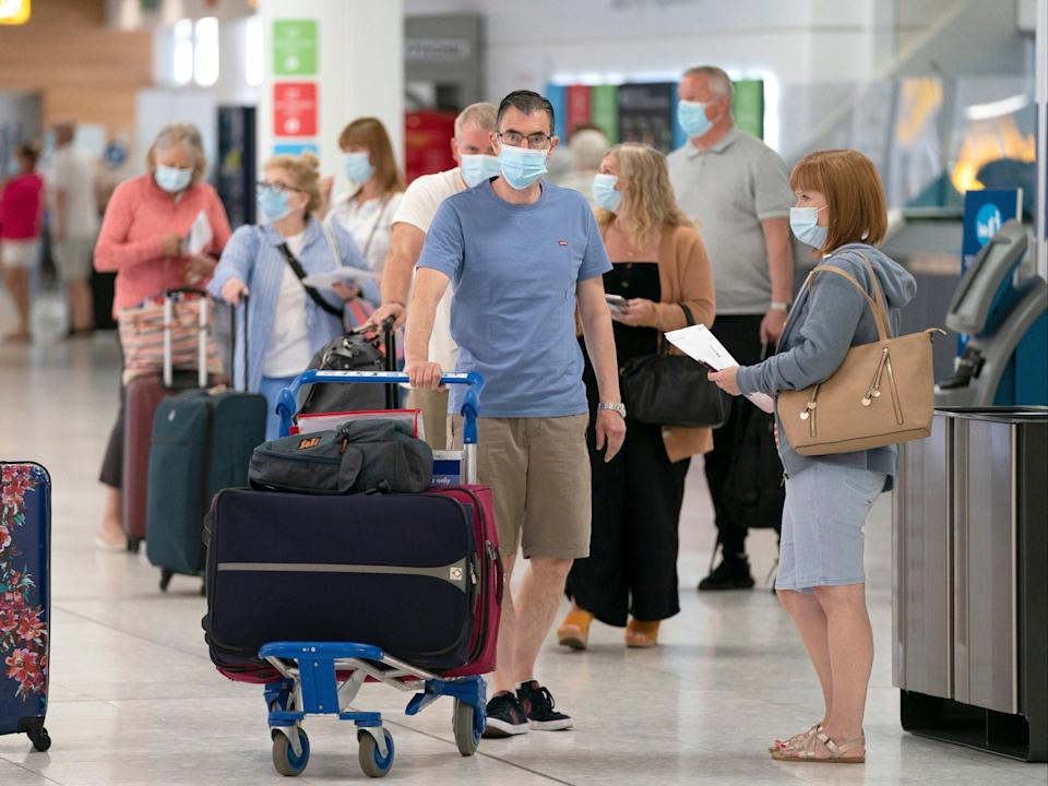 England is to allow people visiting from the US and the EU who are fully vaccinated against coronavirus to enter without the need to quarantine (Jane Barlow/PA )