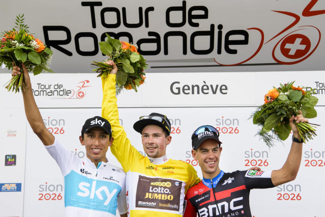 The podium of the 72th Tour de Romandie with second placed, Egan Arley Bernal Gomez from Colombia of team Sky, left, the winner Primoz Roglic from Slovenia of team Lotto NL-Jumbo, center, and the third placed, Richie Porte from Australia of BMC Racing team, right, celebrate on the podium during the fifth and last stage, a 181,8 km race between Mont-sur-Rolle and Geneva during the 72th Tour de Romandie UCI ProTour cycling race in Geneva, Switzerland, Sunday, April 29, 2018. (Jean-Christophe Bott/Keystone via AP)