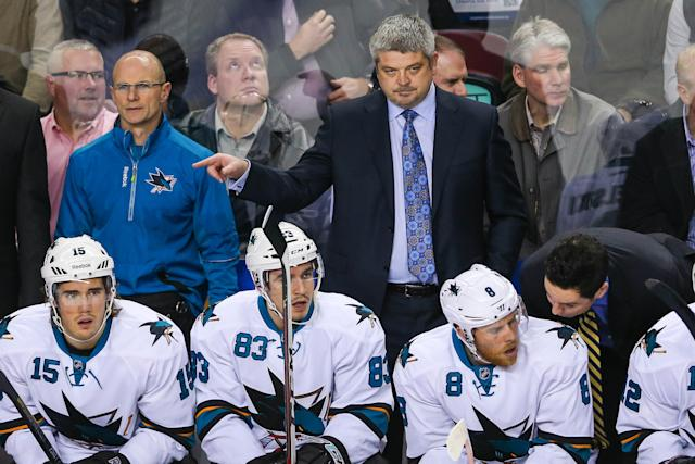 Nov 12, 2013; Calgary, Alberta, CAN; San Jose Sharks head coach Todd McLellan watches game action during the first period against the Calgary Flames at Scotiabank Saddledome. (Sergei Belski-USA TODAY Sports)