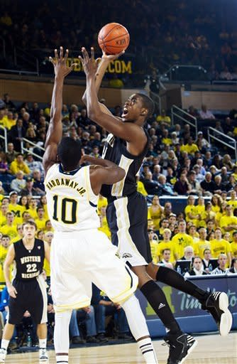 Michigan guard Tim Hardaway Jr., (10) tries to defend Western Michigan forward Darius Paul (24) in the first half of an NCAA college basketball game, Tuesday, Dec. 4, 2012, at Crisler Center in Ann Arbor, Mich. (AP Photo/Tony Ding)