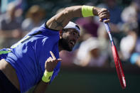 Matteo Berrettini, of Italy, serves to Taylor Fritz at the BNP Paribas Open tennis tournament Tuesday, Oct. 12, 2021, in Indian Wells, Calif. (AP Photo/Mark J. Terrill)