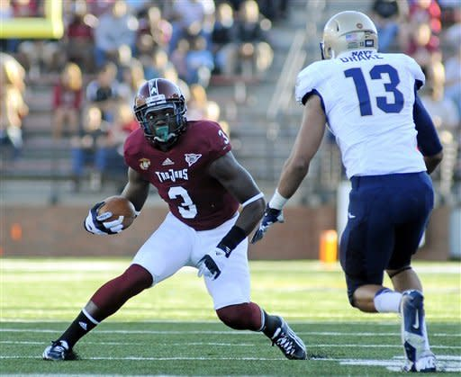 Troy wide receiver Eric Thomas (3) looks for room past Navy linebacker Jordan Drake (13) during the first half of an NCAA college football game in Troy, Ala., Saturday, Nov. 10, 2012. (AP Photo/The (Troy)