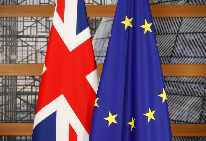 A Union Jack flag and a European Union flag are seen ahead of a bilateral meeting between Britain's Prime Minister and European Council President during the Eastern Partnership summit at the European Council Headquarters in Brussels