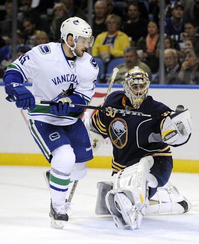 Vancouver Canucks right winger Brad Richardson (15) scores over Buffalo Sabres goaltender Ryan Miller (30) during the second period of an NHL hockey game in Buffalo, N.Y., Thursday, Oct. 17, 2013. (AP Photo/Gary Wiepert)