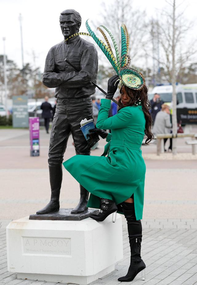 Horse Racing - Cheltenham Festival - Cheltenham Racecourse, Cheltenham, Britain - March 14, 2018 General view of a racegoer next to the statue of AP McCoy before racing REUTERS/Darren Staples