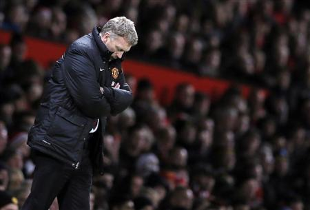 Manchester United's manager David Moyes reacts during their English Premier League soccer match against Swansea City at Old Trafford in Manchester, northern England January 11, 2014. REUTERS/Phil Noble