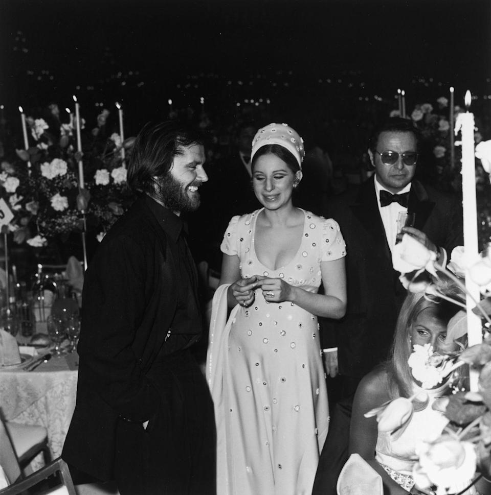 <p>Jack Nicholson rubs elbows with Barbra Streisand during an Academy Awards party in 1970. Nicholson attended the event as a first-time nominee for his role in <em>Easy Rider</em>. </p>