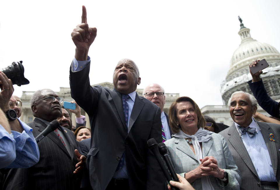 Rep. John Lewis, D-Ga., center, joined by, from left, House Assistant Minority Leader James Clyburn of S.C., Rep. Joseph Crowley, D-N.Y., House Minority Leader Nancy Pelosi of Calif., and Rep. Charles Rangel, D-N.Y., speaks on Capitol Hill in Washington on June 23, 2016, after House Democra/AP)