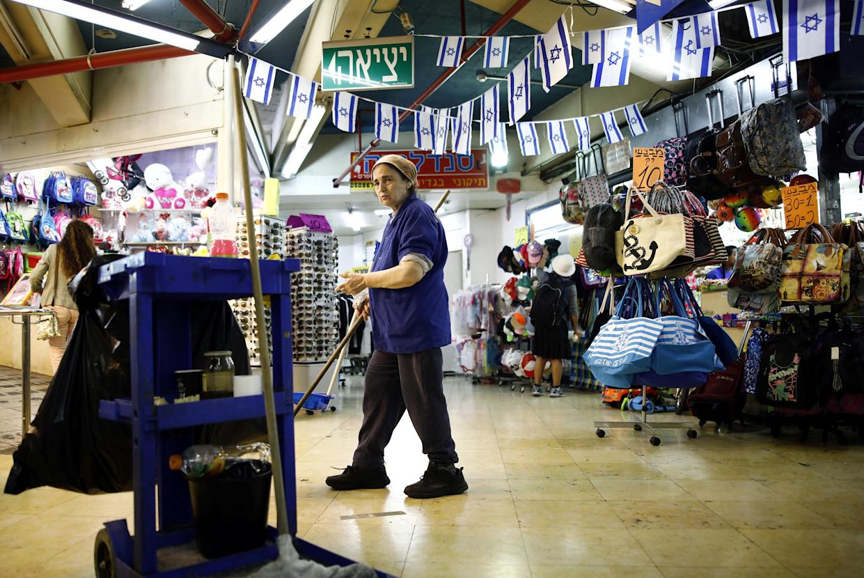 A cleaner near the shops inside the Central Bus Station on May 29. (Photo: Corinna Kern/Reuters)