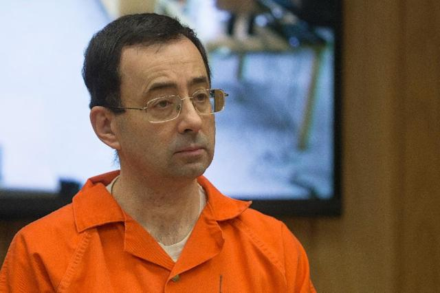 Former US gymnastics team doctor Larry Nassar's sexual abuse scandal has sparked US lawmakers to recommend changes in how the US Olympic Committee functions in order to better safeguard US Olympians (AFP Photo/RENA LAVERTY)