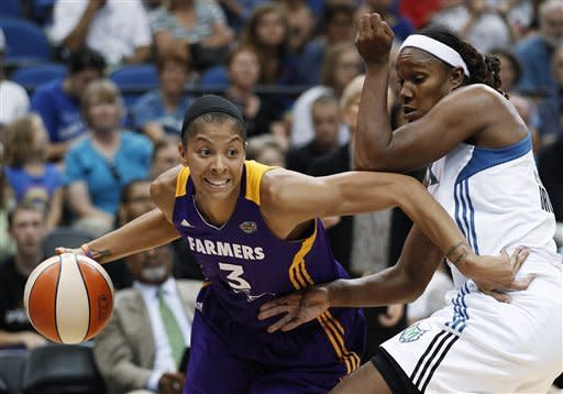 Los Angeles Sparks forward Candace Parker (3) drives past Minnesota Lynx forward Rebekkah Brunson during the second half of a WNBA basketball game, Tuesday, Sept. 4, 2012, in Minneapolis. The Lynx won 88-77. (AP Photo/Stacy Bengs)
