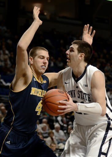 Penn State's Sasa Borovnjak (21) looks for a shot around Michigan's Mitch McGary (4) during the first half of an NCAA college basketball game in State College, Pa., Wednesday, Feb. 27, 2013. Penn State won 84-78. (AP Photo/Ralph Wilson)