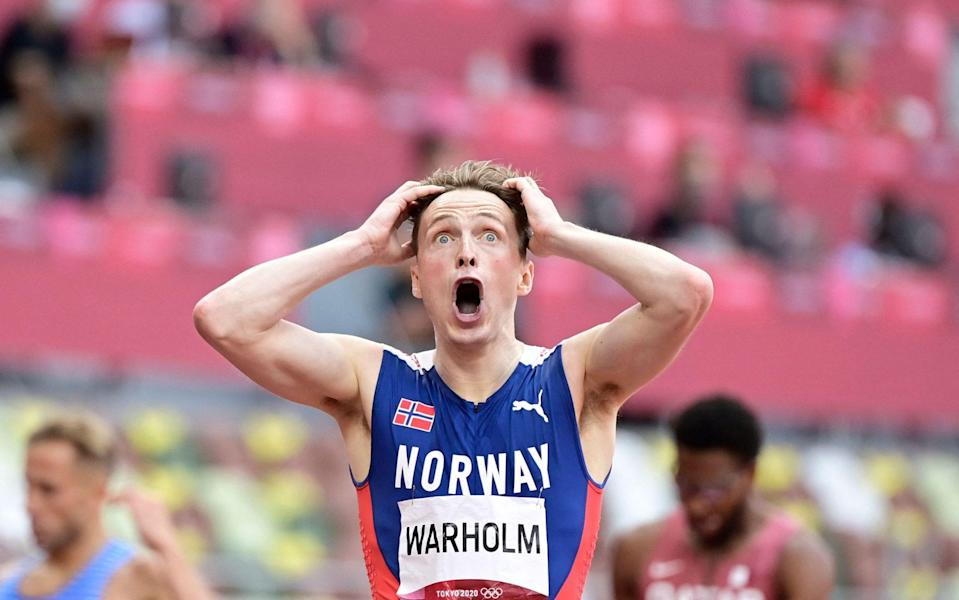 The 400m hurdles final was a close-run affair, and Warholm, the gold-medal winner, faced a nervous look up to the screen - GETTY IMAGES