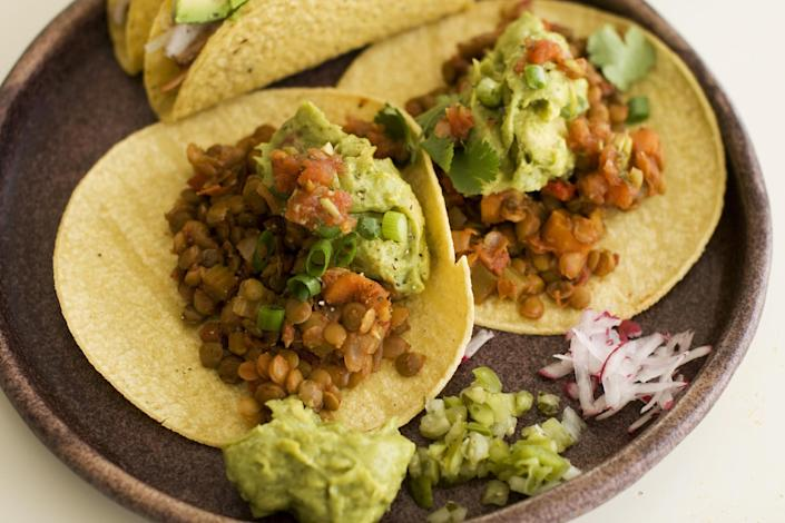 In this image taken on May 13, 2013, lentil tacos are served on a plate as seen in Concord, NH. (AP Photo/Matthew Mead)