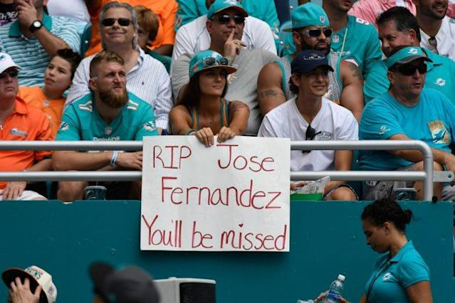 A Miami Dolphins fan holds a sign paying respects to Miami Marlins pitcher Jose Fernandez during the game against the Cleveland Browns on September 25, 2016 in Miami Gardens, Fla. (Eric Espada/Getty Images)