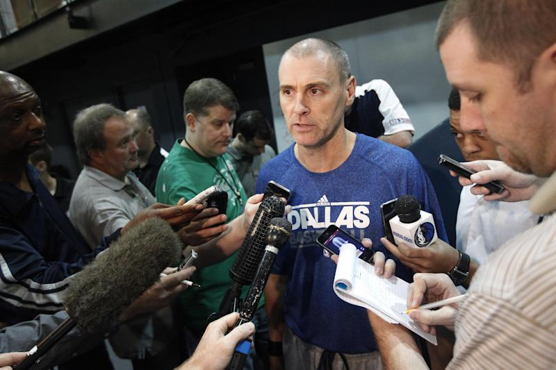 Dallas Mavericks head coach Rick Carlisle, center, addresses reporters following a team practice Thursday, Oct. 25, 2012, in Dallas. The Mavericks suspended guard Delonte West Thursday for unspecified conduct detrimental to the team, his second such ban in the past 10 days.(AP Photo/Tony Gutierrez)