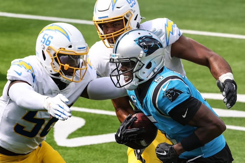 Chargers linebacker Kenneth Murray closes in on Carolina Panthers quarterback Teddy Bridgewater.