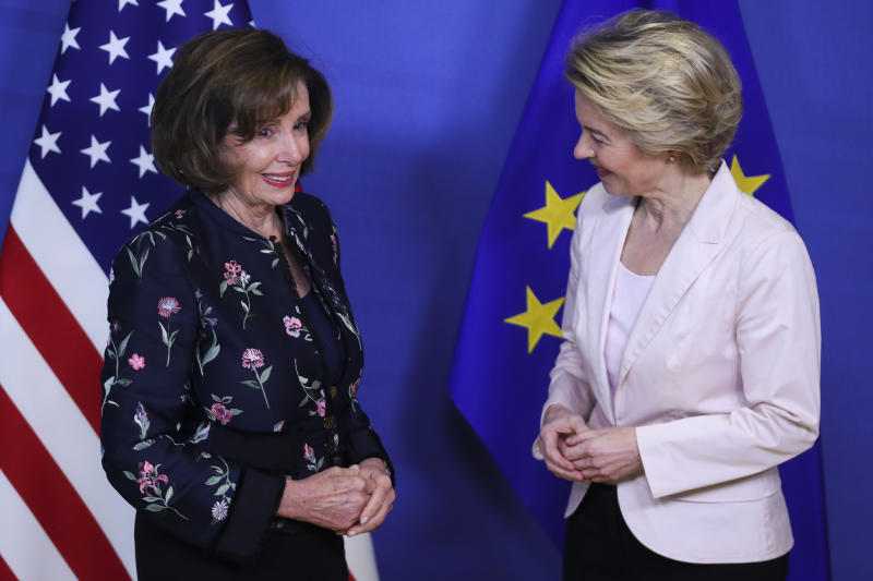 Speaker of the House Nancy Pelosi, D-Calif, left, is welcomed by European Commission President Ursula von der Leyen prior to a meeting at EU headquarters in Brussels, Monday, Feb. 17, 2020. Speaker of the House Nancy Pelosi is on a one day visit to Brussels to meet with leaders of the EU and NATO. (AP Photo/Francisco Seco)
