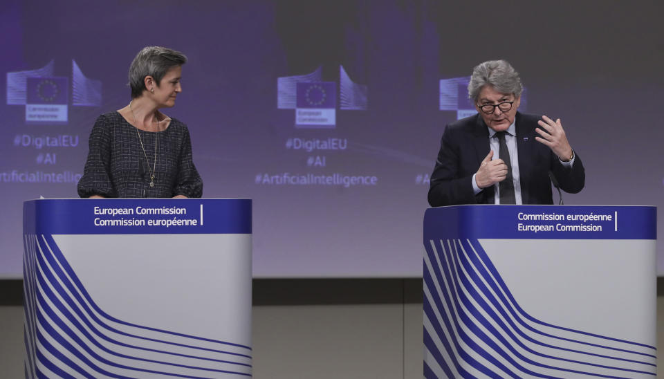 European Commissioner for Europe fit for the Digital Age Margrethe Vestager, left, and European Commissioner in charge of internal market Thierry Breton participate in a media conference on an EU approach to artificial intelligence, following a weekly meeting of EU Commissioners, at EU headquarters in Brussels, Wednesday, April 21, 2021. (Olivier Hoslet, Pool via AP)